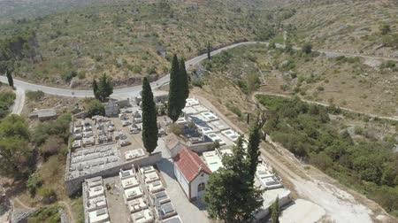 dead valley : Aerial view of mediterranean cemetery between the mountains Stock Footage
