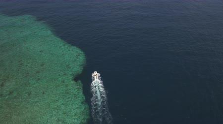 motorbot : Aerial view of a motorboat near the coral reef
