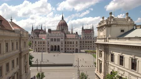 minister : Aerial shot of Hungarian Parliament and flag - Budapest, Hungary