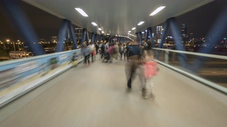 speed tunnel : Hyperlapse shot of busy pedestrian overpass in Hong Kong at night - October 2018: Hong Kong, China