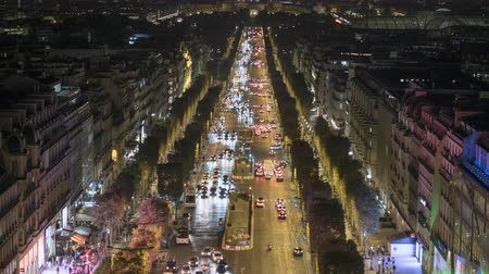 Timelapse shot of Champs Elysees at night. Traffic in Paris downtown - September 2018: Paris, France
