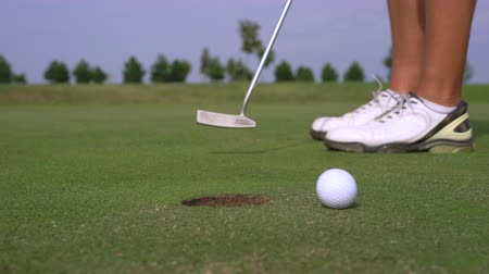 Man golfing and putting in hole. Male player mistake is a golf course - Slider shot
