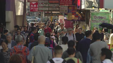 congested : Crowd of people on the street in Mong Kok district, Hong Kong. Many chinese signs on busy street - October 2018: Hong Kong, China