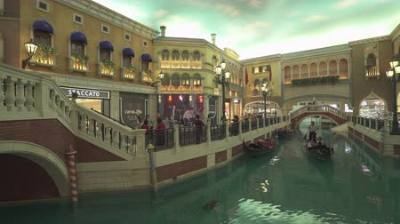 venetian lagoon : Venetian casino and hotel interior. Venice canals inside the hotel. Gimbal tracking shot - October 2018: Macau, China
