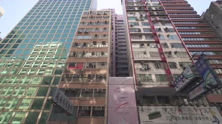 еж : Hong Kong buildings, apartments from below. Tracking gimbal shot - October 2018: Hong Kong, China