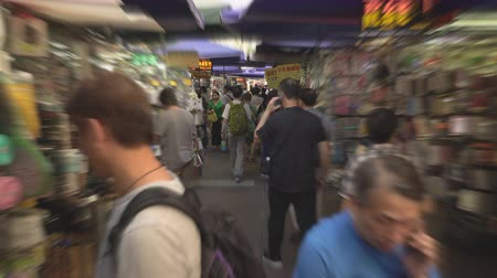congested : Hyperlapse of crowded market in Hong Kong. Busy Fa Yuen or sneaker street market - October 2018: Hong Kong, China Stock Footage