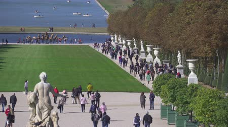 Garden of Versailles palace. Tourists in the park - September 2018: Versailles, France