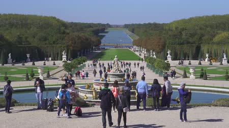 Garden of Versailles palace. Tourists in the fountain - September 2018: Versailles, France