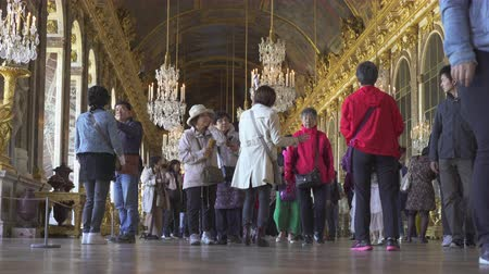 Crowd of people inside the Versailles palace. Palace interior, mirrors room - September 2018: Versailles, France