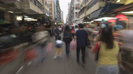 congested : Hyperlapse shot of crowded busy shopping street in Hong Kong at night - October 2018: Hong Kong, China Stock Footage