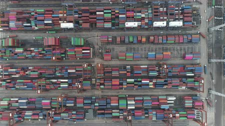 crane fly : Lot of containers in the industrial port. Aerial shot of cargo ship terminal - October 2018 in Hong Kong, China