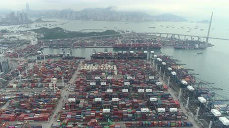 tersane : Aerial shot of Hong Kong port, cargo ship terminal, container dock - October 2018: Hong Kong, China Stok Video