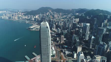 határkő : Aerial shot of Hong Kong city downtown, Asian metropolis - October 2018: Hong Kong, China Stock mozgókép