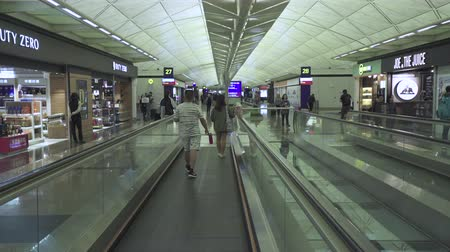 gangway : Hong Kong International airport terminal building, terminal hall, gimbal tracking shot - October 2018: Hong Kong, China
