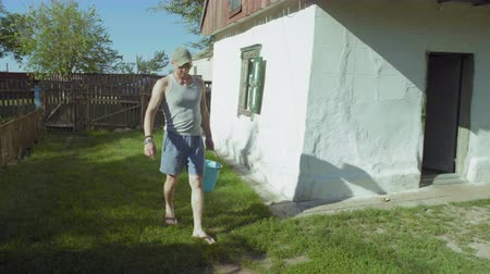 dacha : Rural Man Brings Home a Water Bucket from a Spring