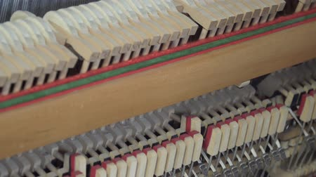 rasgado : Tuning Piano. Close up shot of tuning piano