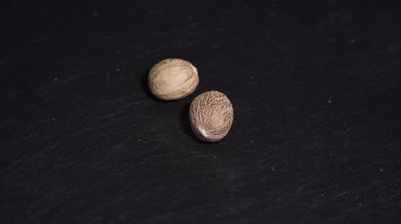lobe : Nutmeg. ingredients for warm wine, mulled wine. circular video. Slow-mo