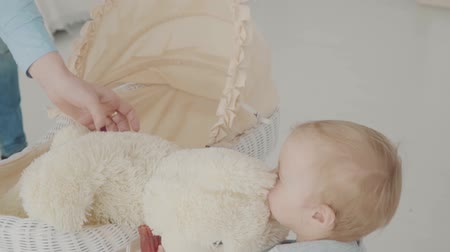 first person : Mother help her little girl touch the bear. Slow Motion. Baby milestone, toddler, 1 year old. Happy childhood