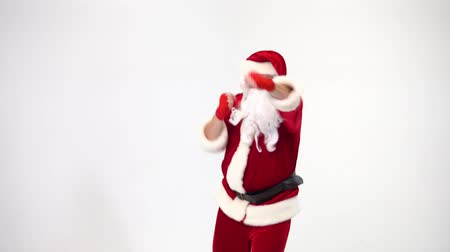 kickbox : Christmas. Santa Claus on a white background in red bows for boxing and kickboxing fulfills blows. The image of a fighter.