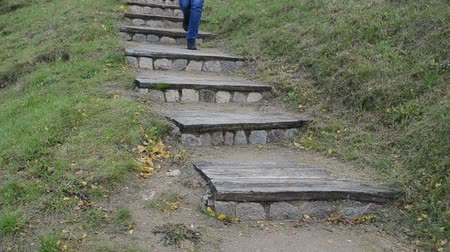 wooden path : retro wooden stone stair in nature park and woman walk downstair.