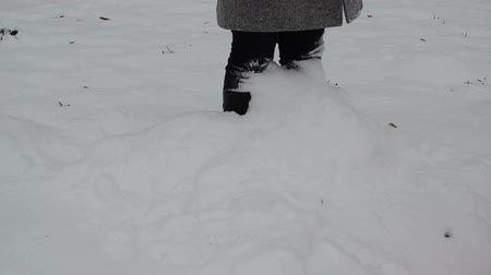 deep snow : woman legs standing in winter snowdrift and dig snow fall on her.