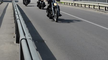 lovas : bikers ride motorcycles on bridge road street on yearly bikers festival.