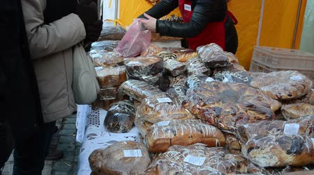 makowiec : People buy various flour products sweet sugary cakes bread in outdoor market fair