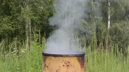 strawberry oil : smoke rise from retro rural handmade barrel smoke house. Stock Footage
