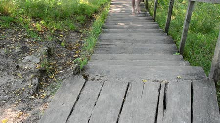 шорты : woman in red shorts climb wooden stairs in park.
