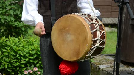 барабаны : Drummer play folk music with drum and stick in rural village party.