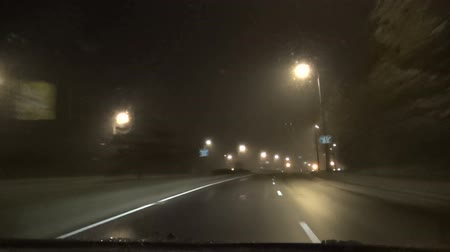 high speed road : fast driving car on late dense evening foggy street