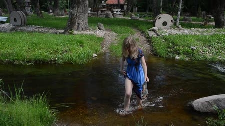 csak a fiatal nők : fast flowing river along the park  wade barefoot girl wet her dress down