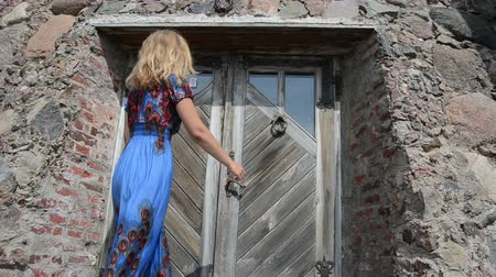 drzwi : guest woman in long dress hand knock retro rusty metal door handle used as buzzer ringer knocker.