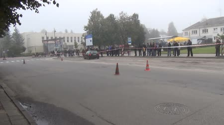 slalom : SIRVINTOS, VILNIUS - MAY 12: car automobile on slalom autocross competition and public people audience in morning fog on May 12, 2012 in Sirvintos, Lithuania. Stock Footage