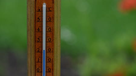 temp : Fast rising temperature on wooden outdoor thermometer scale. Celsius measurement unit. Stock Footage