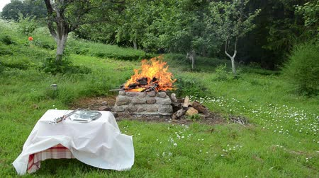 сухой : by the fire stands a small table covered with a white  tight tablecloth
