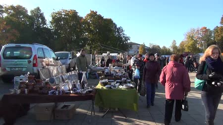 kamenina : BIRZAI, LITHUANIA - OCTOBER 05: annual autumn fair in the citys central square. Vendors stand in their stalls people walking looking around on October 05, 2013 in Birzai, Lithuania.