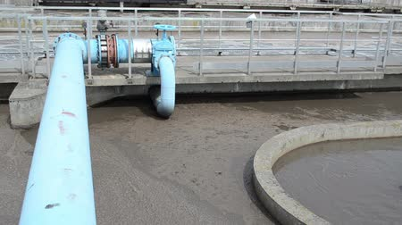 liquidação : Panorama of sewage water sludge settling mechanism in water treatment plant facility. Dirty fluid flowing.