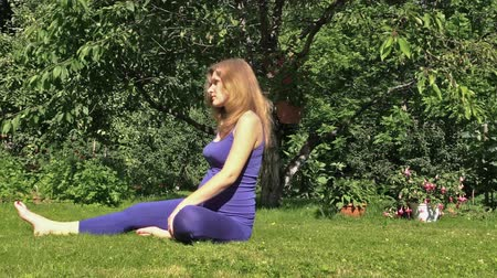 yaşam tarzı : Pregnant woman yoga exercise during pregnancy outdoor at park. Concept of healthy life style and health care. Static shot on Canon XA25. Full HD 1080p. Progressive scan 25fps. Tripod.