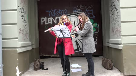 fife : VILNIUS, LITHUANIA - MAY 16: Musicians student girls play with flute fife pipe in old town street free event on May 16, 2015 in Vilnius, Lithuania. Street music day. 4K Stock Footage