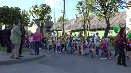 chant : SIRVINTOS, LITHUANIA - JUNE 29: Group of children march and chant on city anniversary parade and holiday summer holiday event on June 29, 2015 in Sirvintos, Lithuania. Static shot. 4K