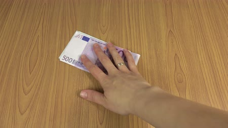 payment : man hand give bunch of euro cash banknotes bribe for woman on table. Corruption concept. Illegal payment for work. Shadow economy. Closeup shot. 4K UHD video clip. Stock Footage
