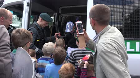 bulletproof : VILNIUS, LITHUANIA - MAY 31,2015: Police shotgun demonstration for children on May 31, 2015 in Vilnius, Lithuania. National children day. Static shot. 4K
