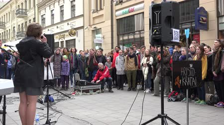 waggle : VILNIUS, LITHUANIA - MAY 16, 2015: young musicians group with vocalist woman sing and play popular music outdoors on May 16, 2015 in Vilnius, Lithuania. Street music day. Static shot. 4K Stock Footage
