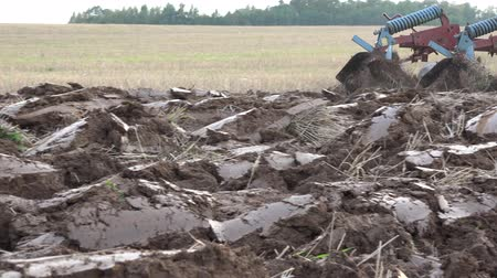 reclaim : tractor till plow turn up field soil in farm arable field. Panorama follow shot. 4K