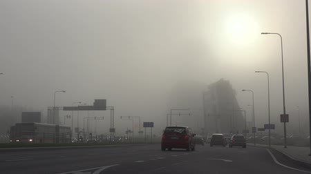 тревожный : VILNIUS, LITHUANIA - SEPTEMBER 30, 2015: Severe smog lies like a shroud over city on September 30, 2015 in Vilnius, Lithuania. Big cities face serious pollution and poor air quality. Static shot. Стоковые видеозаписи