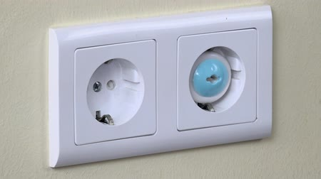 receptacle : Hand pull out plug wire from outlet and insert child safety plug Stock Footage