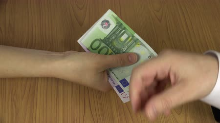 venality : Illegal payment for work. Hand give euro banknotes. 4K