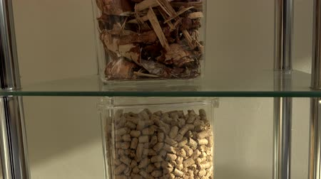 briquettes : various kind of bio pellets natural bio fuel in exposition Stock Footage