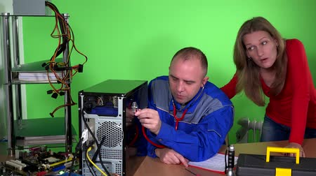 charlatan : Computer specialist guy with stethoscope examining pc and customer girl